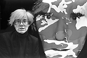 Andy Warhol with self portrait, London