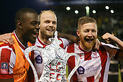 Lincoln City Forward Theo Robinson and Lincoln City Midfielder Alan Power celebrate with replica FA Cup during the The FA Cup fourth round match between Lincoln City and Brighton and Hove Albion at Sincil Bank, Lincoln, United Kingdom on 28 January 2017. Photo by Phil Duncan.