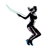 one caucasian woman Jumping Rope exercises  in studio silhouette isolated on white background