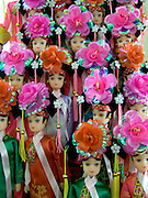 souvenir Barbie like dolls displayed in Chinese traditional dress in China