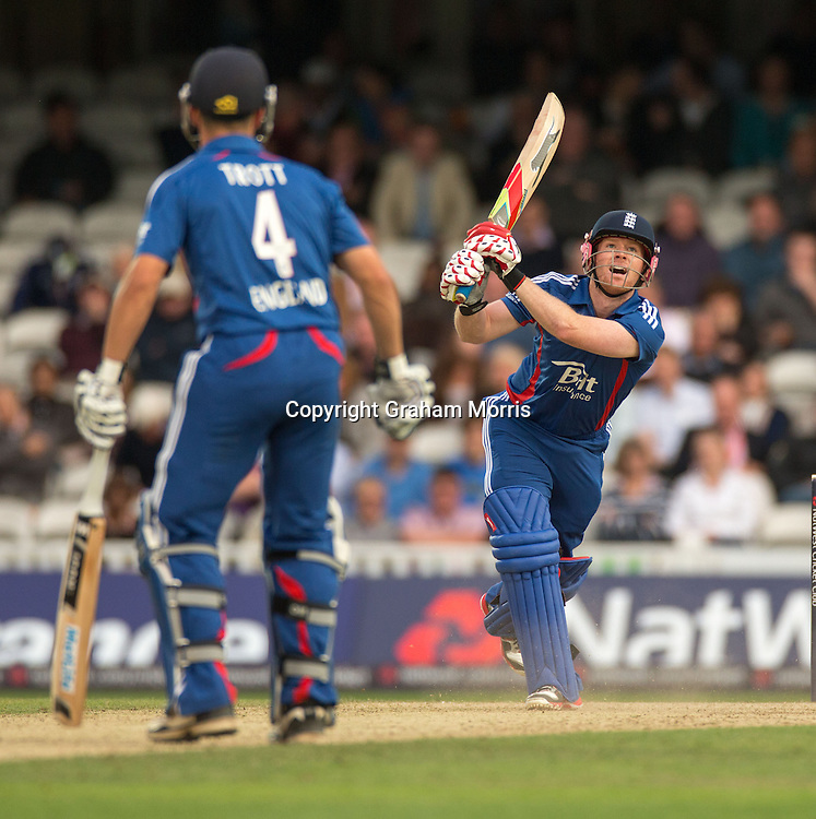 Eoin Morgan, four off Robin Petersen (past Jonathan Trott) during the third NatWest Series one day international between England and South Africa at the Kia Oval, London. Photo: Graham Morris (Tel: +44(0)20 8969 4192 Email: sales@cricketpix.com) 31/08/12