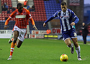 Wigan Striker Yanic Wildschut attacks during the Sky Bet League 1 match between Wigan Athletic and Blackpool at the DW Stadium, Wigan, England on 12 December 2015. Photo by Pete Burns.