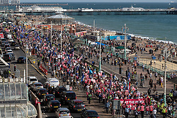 © Licensed to London News Pictures . 21/09/2019. Brighton, UK. The march passes the Brighton Centre . Thousands attending a march organised by the People's Vote for a second EU referendum on Brexit pass through Brighton and along the Promenade during the first day of the 2019 Labour Party Conference from the Brighton Centre . Photo credit: Joel Goodman/LNP