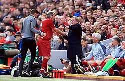 Liverpool's Alan Kennedy with manager Kenny Dalglish (right) during the Legends match at Anfield Stadium, Liverpool.