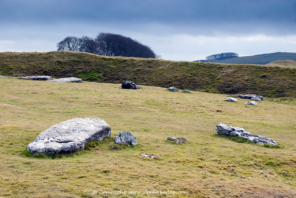 Derbyshire, UK 8 March: Storm clouds roll in above Arbor Low Stone Circle on a changeable Spring day on 8 March 2015 at the Peak District