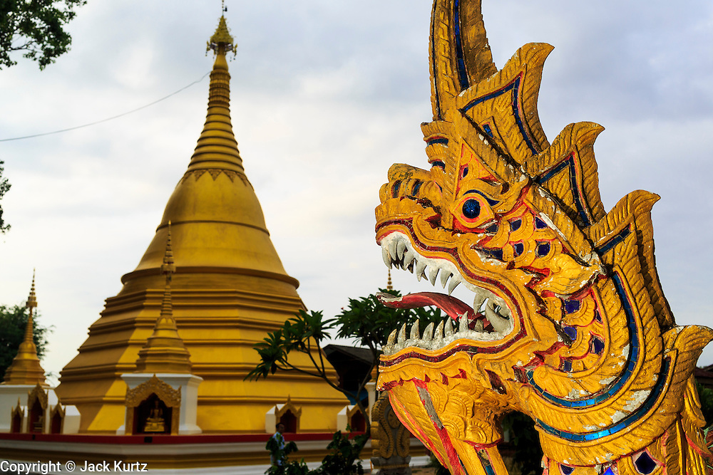24 MAY 2013 - MAE SOT, THAILAND:    The Naga (mythical serpent) in front of the chedi at Wat Mae Pa in Mae Sot. Nagas are throught to protect the temple and holy buildings from evil.    PHOTO BY JACK KURTZ