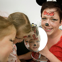 FREE TO USE PHOTOGRAPH.....St Johns Shopping Centre in Perth gets into the spirit of the 4th July. Facepainter Alison Pibworth shows twins Niamh and Elidh McDonald their 'Minnie Mouse' faces<br /> for further info contact Tricia Fox on 01738 658187<br /> Picture by Graeme Hart.<br /> Copyright Perthshire Picture Agency<br /> Tel: 01738 623350  Mobile: 07990 594431