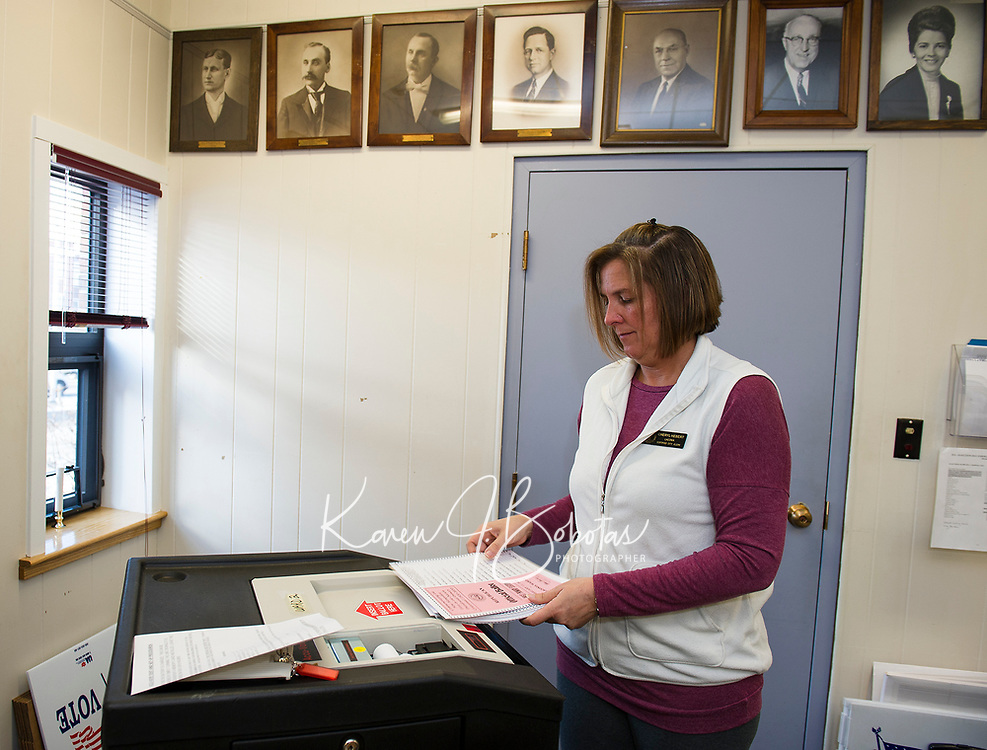 Laconia City Clerk Cheryl Hebert runs ballots through the voting machine for Ward 2 on Monday morning in prepatation for the New Hampshire Presidential Primary on February 11, 2020.   (Karen Bobotas/for the Laconia Daily Sun)