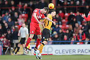 York City defender, on loan from Newcastle United, Kyle Cameron in a duel with Newport County forward Aaron Collins  during the Sky Bet League 2 match between York City and Newport County at Bootham Crescent, York, England on 16 January 2016. Photo by Simon Davies.