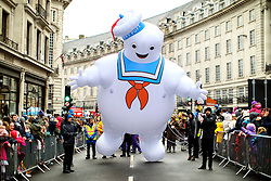 © Licensed to London News Pictures. 20/11/2016. London, UK. A giant Marshmallow Man and over 400 other cast members of Hamley's Toy Parade march along Regent Street in London in a colourful extravaganza, with marching bands, dancers and toy vehicles. Photo credit: Tolga Akmen/LNP