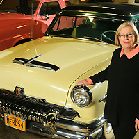 Jane Spain, curator of the Tupelo Automobile Museum, stands next to the 1954 Mercury Sun Valley, a car she rode home in from Alaska with her husband Frank after buying the car for his collection.