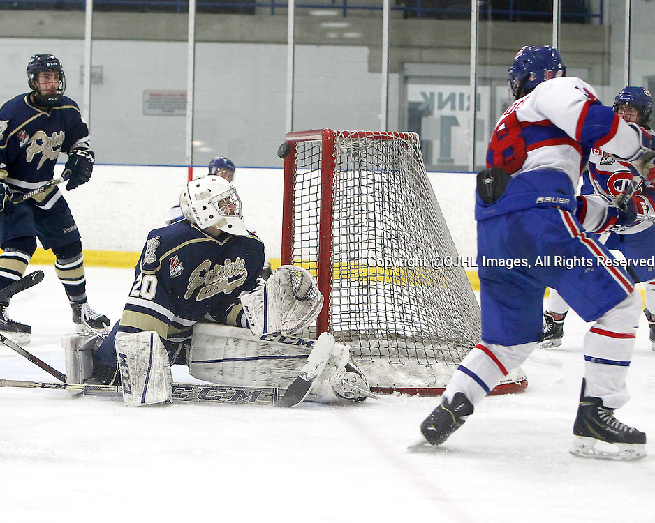 TORONTO, ON - Apr 5, 2015 : Ontario Junior Hockey League game action between the Toronto Jr. Canadiens and the Toronto Patriots.  Game six of the South West Championship Series. Mathew Robson #20 makes the save in the third period.<br /> (Photo by Brian Watts / OJHL Images)