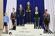 Iowa City High's Lizzie Brown stands on the top of the podium for her first place finish in the 100 yard breaststroke event at the Girls' High School State Swimming & Diving Championships at the Marshalltown YMCA/YWCA in Marshalltown on Saturday, November 9, 2013. Brown placed first with a time of 1:03.86.