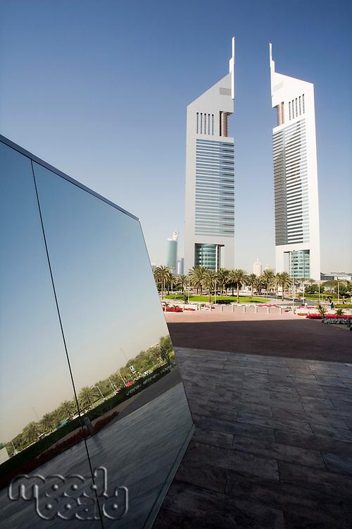UAE Dubai reflection in a mirrored piece of artwork on display at the Dubai International Financi