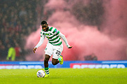 Odsonne Edouard (#22) of Celtic brings the ball forward in front of a cloud of red smoke during the Betfred Cup Final between Celtic and Aberdeen at Celtic Park, Glasgow, Scotland on 2 December 2018.