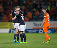 August 9th 2017, Dens Park, Dundee, Scotland; Scottish League Cup Second Round; Dundee versus Dundee United; Dundee's Kevin Holt and Randy Wolters celebrate at full time while Dundee United's Stewart Murdoch watches