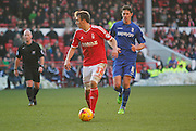 Robert Tesche and Birmingham's Nikola Zigic during the Sky Bet Championship match between Nottingham Forest and Birmingham City at the City Ground, Nottingham, England on 28 December 2014. Photo by Jodie Minter.