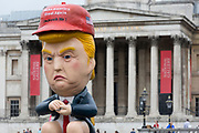 On US President Donald Trump's second day of a controversial three-day state visit to the UK, a Trump effigy tweets while sitting on a golden toilet outside the National gallery as protesters voice their opposition to the 45th American President, in Trafalgar Square, on 4th June 2019, in London England.