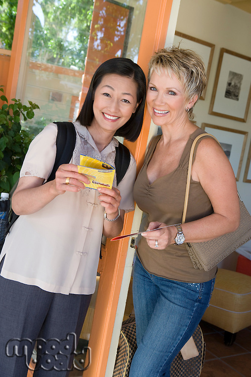 Two women with tickets on vacation, portrait
