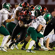 22 September 2018: San Diego State Aztecs defensive lineman Chibu Onyeukwu (55) tackles Eastern Michigan Eagles running back Ian Eriksen (25) in the second quarter. The San Diego State Aztecs beat the Eastern Michigan Eagles 23-20 in over time at SDCCU Stadium in San Diego, California.
