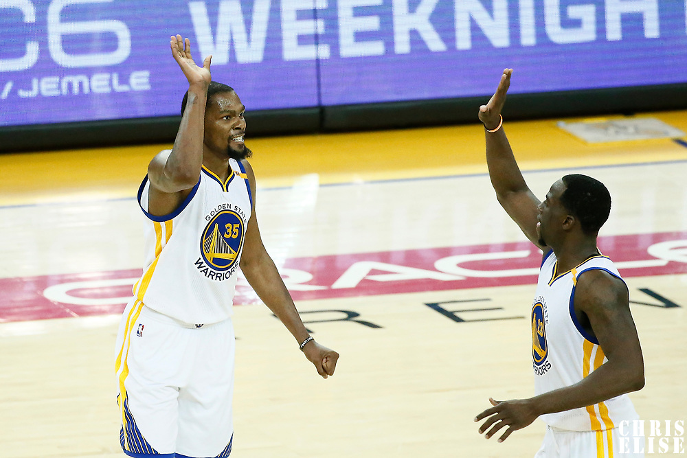 12 June 2017: Golden State Warriors forward Kevin Durant (35) celebrates with Golden State Warriors forward Draymond Green (23) during the Golden State Warriors 129-120 victory over the Cleveland Cavaliers, in game 5 of the 2017 NBA Finals, at the Oracle Arena, Oakland, California, USA.