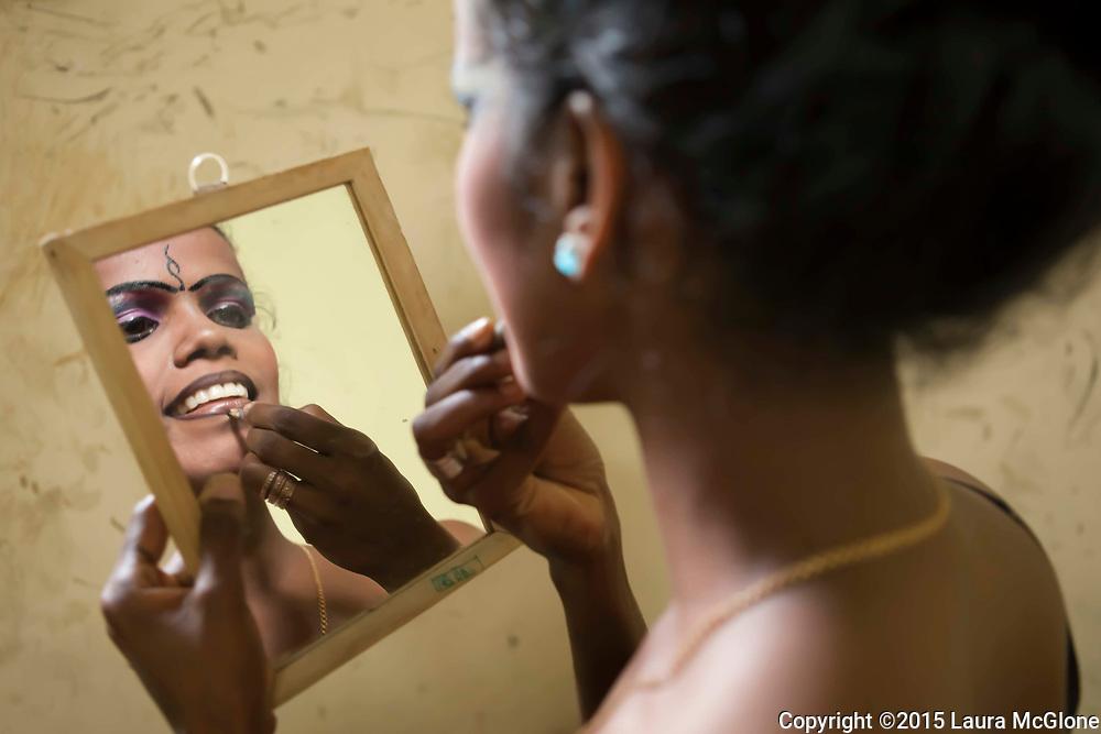 Sri Lanka - Kandyan Dancer putting on makeup preparations for dance