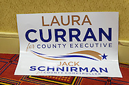 Uniondale, New York, USA. January 30, 2017. A sign supporting Democrats Laura Curran, candidate for Nassau County Executive, and Jack Schnirman, candidate for County Comptroller, is left behind after a press conference during which  each candidate received an endorsement from Democratic Party leaders. Curran is in her 2nd term as Nassau County Legislator for the 5th District. A primary is expected for County Exec. Jack Schnirman is Long Beach manager and has never held elected office.