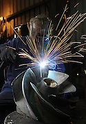 Sparks fly at a manufacturing plant during an industrial photo shoot in Port Arthur, Texas.