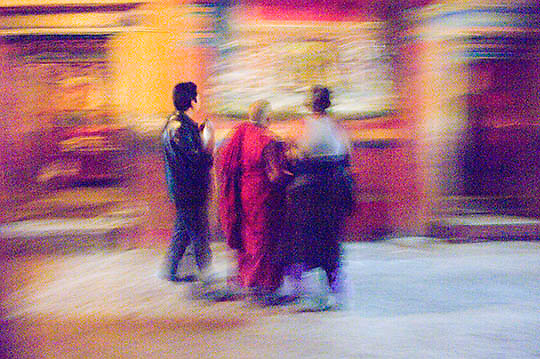 Local Tibetans and monk.