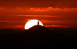 © Licensed to London News Pictures. 08/12/2012. CITY/TOWN e.g Windsor, UK Sunset tonight of Glastonbury Tor in Somerset. Photo credit : Jason Bryant/LNP