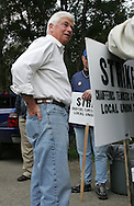 Democratic presidential candidate and Senator Chris Dodd (D-CT)  talks with striking union workers outside the Cargill plant in Cedar Rapids on Thursday, October 11, 2007.
