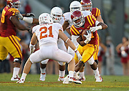 October 01, 2011: Iowa State Cyclones running back Shontrelle Johnson (21) tries to get by Texas Longhorns safety Blake Gideon (21) during the first half of the game between the Iowa State Cyclones and the Texas Longhorns at Jack Trice Stadium in Ames, Iowa on Saturday, October 1, 2011. Texas defeated Iowa State 37-14.