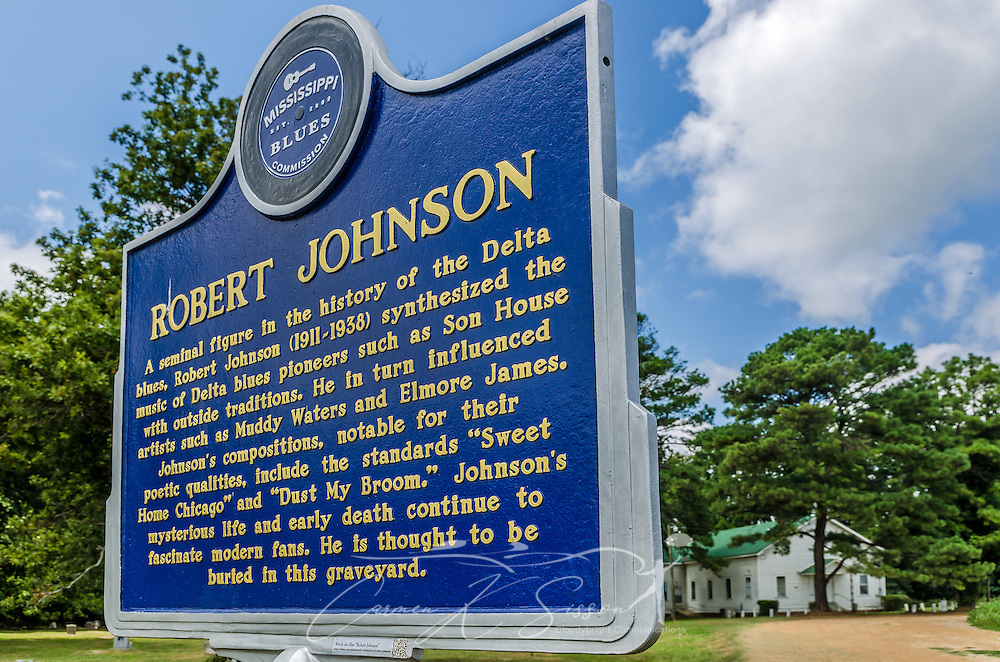 A historic marker by the Mississippi Blues Commission, commemorates the spot close to where legendary blues musician Robert Johnson allegedly died. Three different locations have been identified as his possible burial site, including this one on Money Road at Little Zion Missionary Baptist Church. (Photo by Carmen K. Sisson)