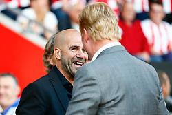 Vitesse Arnhem manager Peter Bosz jokes with Southampton manager Ronald Koeman - Mandatory by-line: Jason Brown/JMP - Mobile 07966386802 - 31/07/2015 - SPORT - FOOTBALL - Southampton, St Mary's Stadium - Southampton v Vitesse Arnhem - Europa League