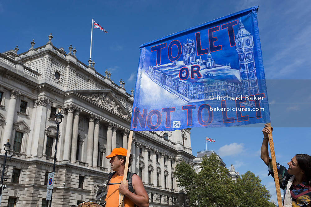 Pro-EU Remain protesters march to 'Stop the Coup' in Whitehall, near Downing Street, at the end of a week that saw Prime Minister Boris Johnson ask Queen Elizabeth for permission to suspend (prorogue) the British Parliament during the final stages of his Brexit negotiations with the European Union, in Brussels, on 31st August 2019, in Westminster, London, England.