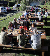 Guests at the Idaho Rocky Mountain Lodge in the Sawtooth Mountains enjoy a southwest fajita buffet dinner that included barbecued swordfish, flank steak, and chicken on Saturday night, July 13 2013, south of the town of Stanley, ID.