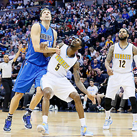06 March 2016: Dallas Mavericks forward Dirk Nowitzki (41) vies for the rebound with Denver Nuggets forward Will Barton (5) next to Denver Nuggets guard D.J. Augustin (12) during the Denver Nuggets 116-114 overtime victory over the Dallas Mavericks, at the Pepsi Center, Denver, Colorado, USA.