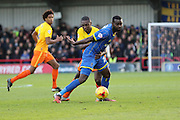 Karleigh Osborne of AFC Wimbledon and Anthony Stewart of Wycombe Wanderers tussle during the Sky Bet League 2 match between AFC Wimbledon and Wycombe Wanderers at the Cherry Red Records Stadium, Kingston, England on 21 November 2015. Photo by Stuart Butcher.