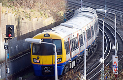 © under license to London News Pictures. 02/01/14. An average 2.8% increase in rail fares comes into effect on Thursday 2nd Jan 2014, pushing the cost of some commuter travel to more than £5,000 a year. FILE PICTURE DATED:  02/01/2011. A Train passing through Kensal Green, North West London today (02/01/2010). Rail fares are due to rise today (02/01/2010) with some fares due to go up up almost 13%. Overall, main line fares are rising by an average of 6.2%, with regulated fares, which include season tickets, going up by average of 5.8%. Photo credit should read Sam Long/ London News Pictures