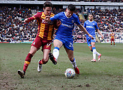 Alex Gilliead of Bradford City and Gillingham midfielder Callum Reilly contest a loose ball  during the EFL Sky Bet League 1 match between Bradford City and Gillingham at the Northern Commercials Stadium, Bradford, England on 24 March 2018. Picture by Paul Thompson.