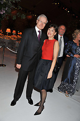 The French Ambassador to the UK H.E. BERNARD EMIE and his wife ISABELLE EMIE at a dinner hosted by Cartier following the following the opening of the Chelsea Flower Show 2012 held at Battersea Power Station, London on 21st May 2012.