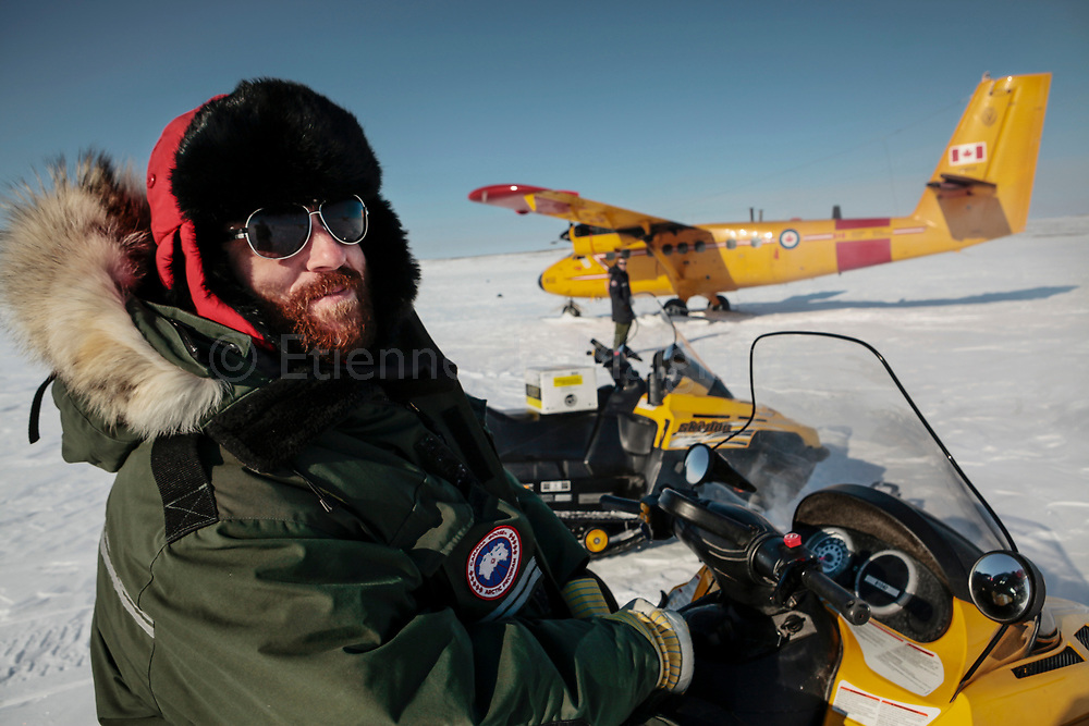 Adam Day, military reporter with Ottawa-based  Legion Magazine, as he watches a Canadian Air Forces Twin Otter resupplying a Rangers patrol during Nunalivut 2012 exercise. Devon Island, 18 April 2012.