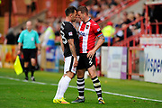 Neal Eardley (23) of Lincoln City and Pierce Sweeney (2) of Exeter City clash during the EFL Sky Bet League 2 match between Exeter City and Lincoln City at St James' Park, Exeter, England on 19 August 2017. Photo by Graham Hunt.