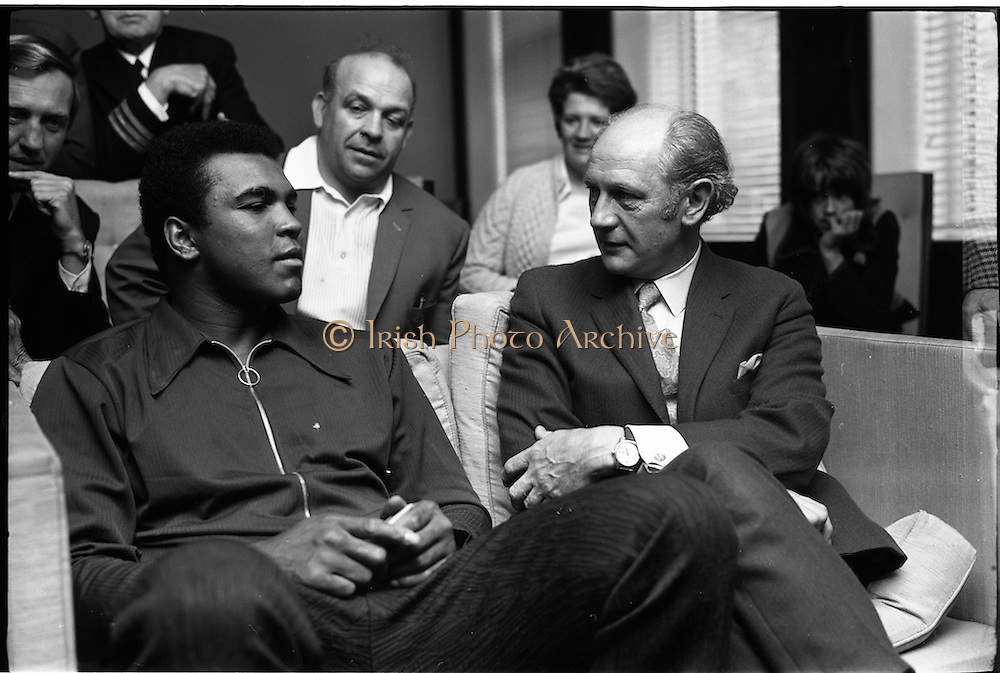 """12/07/1972<br /> 07/12/1972<br /> 12 July 1972<br /> Muhammad Ali meets Taoiseach Jack Lynch at Leinster House, Dublin. In the background is Butty Sugrue who organised the fight between Ali and Al """"Blue"""" Lewis."""