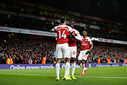 GOAL 4-1 Arsenal striker Pierre-Emerick Aubameyang (14) celebrates with Arsenal midfielder Bukayo Saka (87) and Arsenal midfielder Ainsley Maitland-Niles (15) after Arsenal's fourth during the Premier League match between Arsenal and Fulham at the Emirates Stadium, London, England on 1 January 2019.
