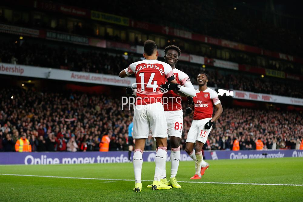 GOAL 4-1 Arsenal striker Pierre-Emerick Aubameyang (14) celebrates with Arsenal midfielder Bukayo Saka (87) and Arsenal midfielder Ainsley Maitland-Niles (15) after Arsenal's fourth during the Premier League match between Arsenal and Fulham at the Emirates Stadium, London, England on 1 January 2019.
