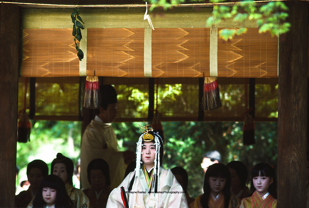 """Attendents with Miss Kazusa Nihimura (20 years old) the queen """"Saiodai""""  at Misogi - No-Shinji the ceremony of purification & baptism. This is a pre event of the Aoi Matsuri (festival) Kamikamo Shrine, Kyoto, Japan"""