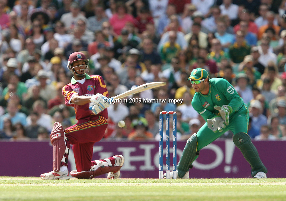 Lendl Simmons of the West Indies sweeps as Mark Boucher of South Africa keeps wicket. West Indies v South Africa, World T20, Cricket, The Oval, 13/06/2009 © Matthew Impey/Wiredphotos.co.uk. tel: 07789 130 347 email: matt@wiredphotos.co.uk