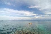 Emerging rock from sea bed in shore of island at Kuna Yala. San Blas archipelago, Panama, Caribbean, Central America.