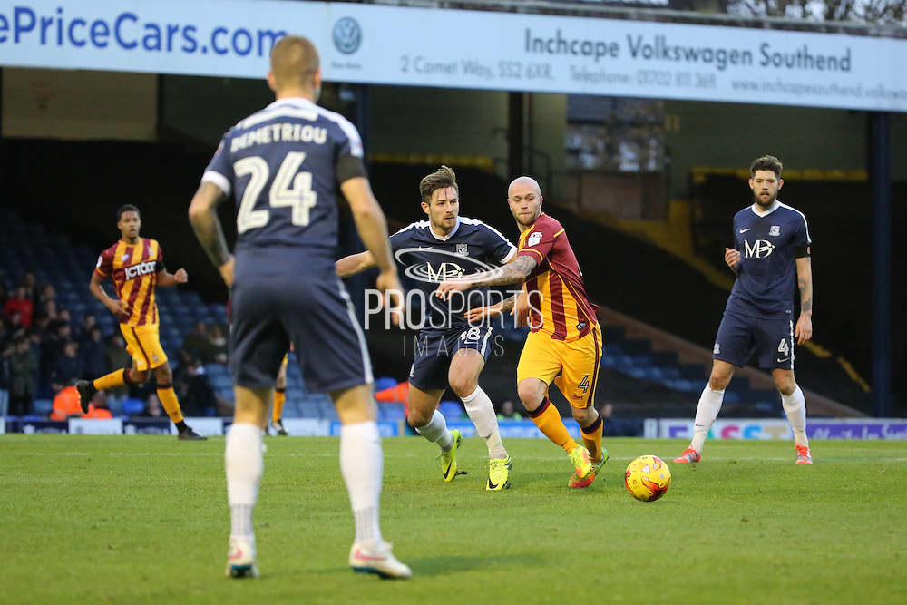 Bradford City midfielder Nicky Law (4) battles for the ball with Southend United defender Ryan Leonard (18) during the EFL Sky Bet League 1 match between Southend United and Bradford City at Roots Hall, Southend, England on 19 November 2016. Photo by Matthew Redman.